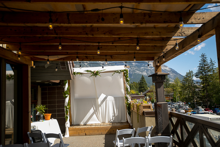 a summer wedding details of the ceremony in the hive gallery canmore alberta