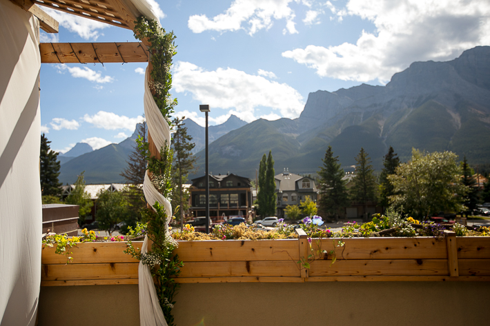 a summer wedding details of the ceremony with mountains in the hive gallery canmore alberta