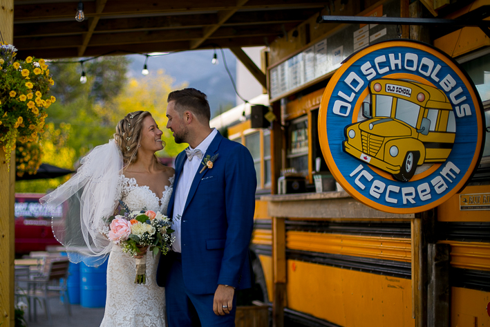 a summer wedding couple photo at an ice cream truck canmore alberta