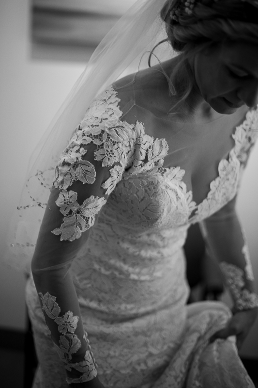 a summer wedding of the bride getting ready in the hive gallery canmore alberta