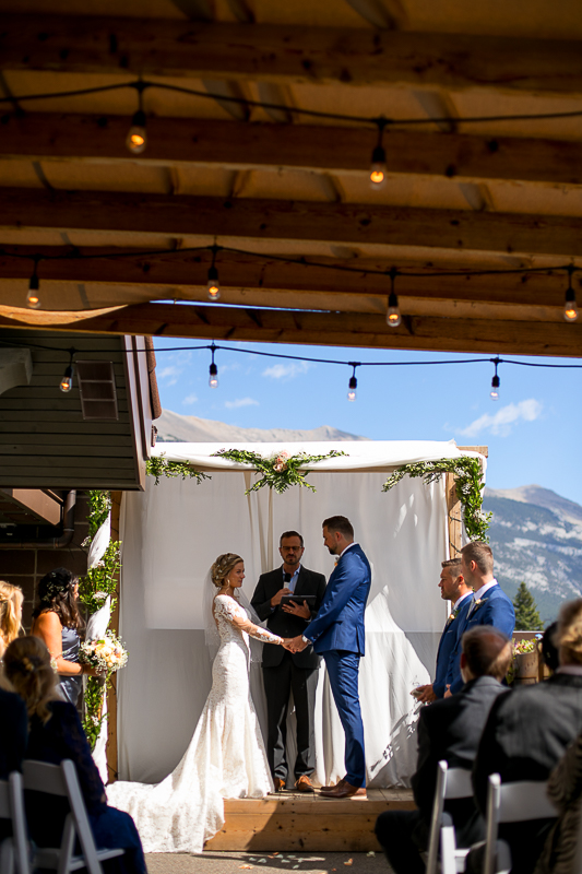 a summer wedding of the ceremony in the hive gallery canmore alberta