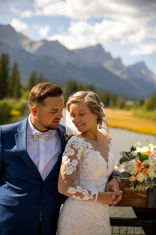 a summer wedding couple photo on the policeman's boardwalk canmore alberta