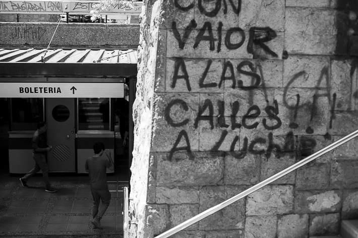 a travel photo of a metro station during the wage protests in santiago, chile, south america