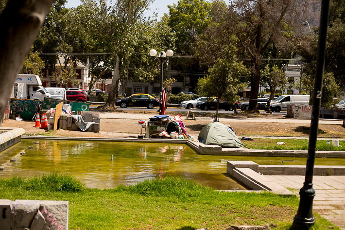 a travel photo of the downtown square with people camped out during the wage protests in santiago, chile, south america