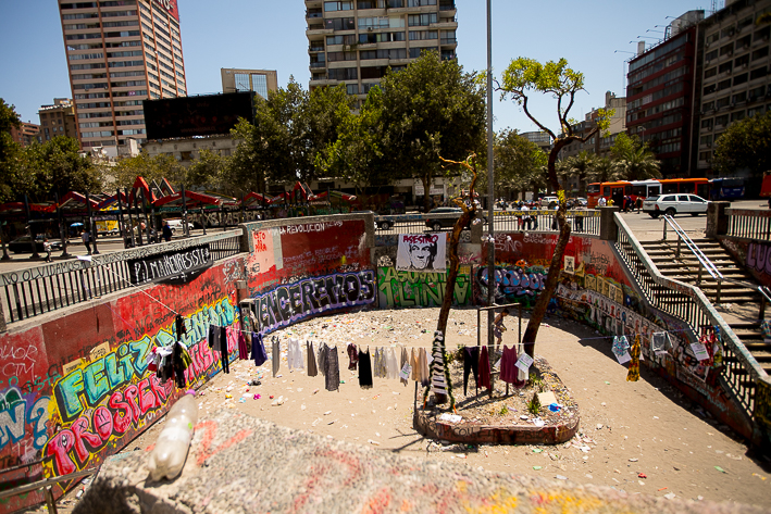 a travel photo of the downtown square with other peoples clothes with out during the wage protests in santiago, chile, south america