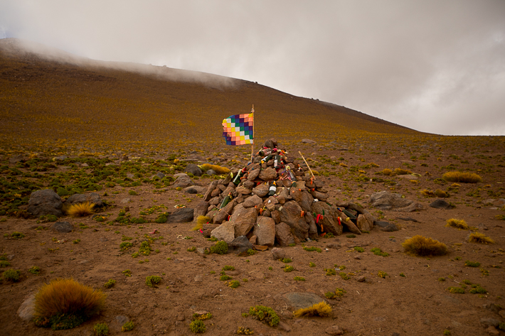 a travel photo of the flags on the peek of the mountain in atacama desert, chile south america