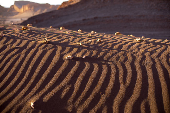 a travel photo of the valley of the moon sun shadow chile south america