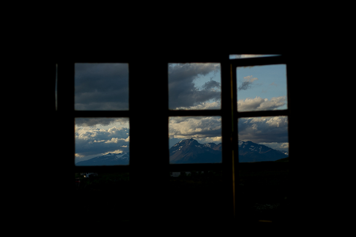 a travel photo of the sunset of a view of torres del paine in puerto natales chile south america