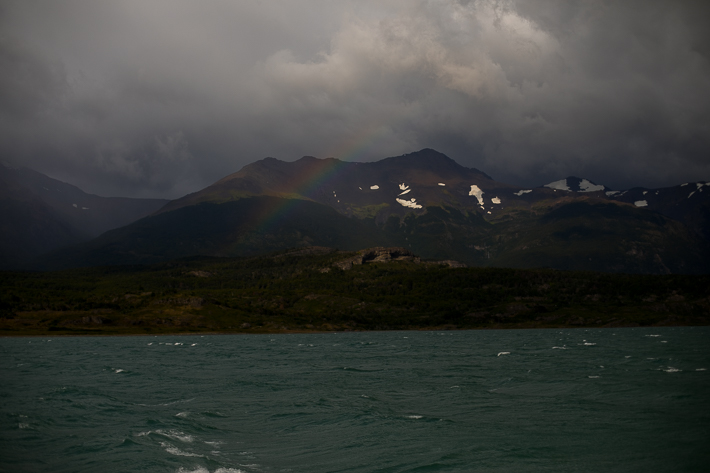a travel photo of a rainbow with turquoise water in los glaciares national park in torres del paine chile south america