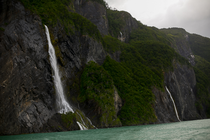 a travel photo of multiple waterfalls in los glaciares national park inside torres del paine chile south america