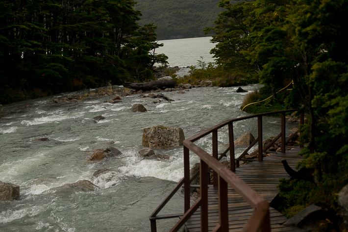 a travel photo of a a bride with rushing water in los glaciares national park inside torres del paine chile south america