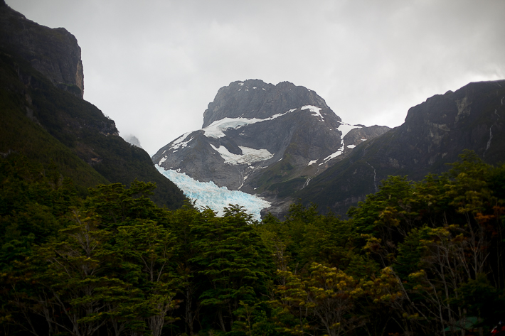 a travel photo of a a lush mountain with glaciers in los glaciares national park inside torres del paine chile south america
