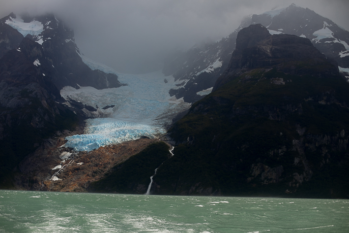 a travel photo of turquoise water in sunlight los glaciares national park in torres del paine chile south america