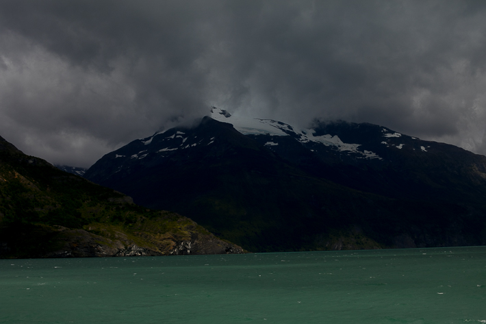 a travel photo of turquoise water with a mountain in los glaciares national park in torres del paine chile south america