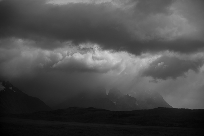 a travel photo of a cloudy day with mountains in los glaciares national park in torres del paine chile south america
