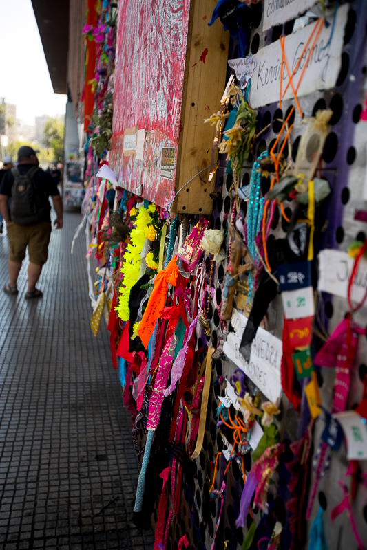 a travel photo of an art museum with bloody shirts hanging during the wage protests in santiago, chile, south america