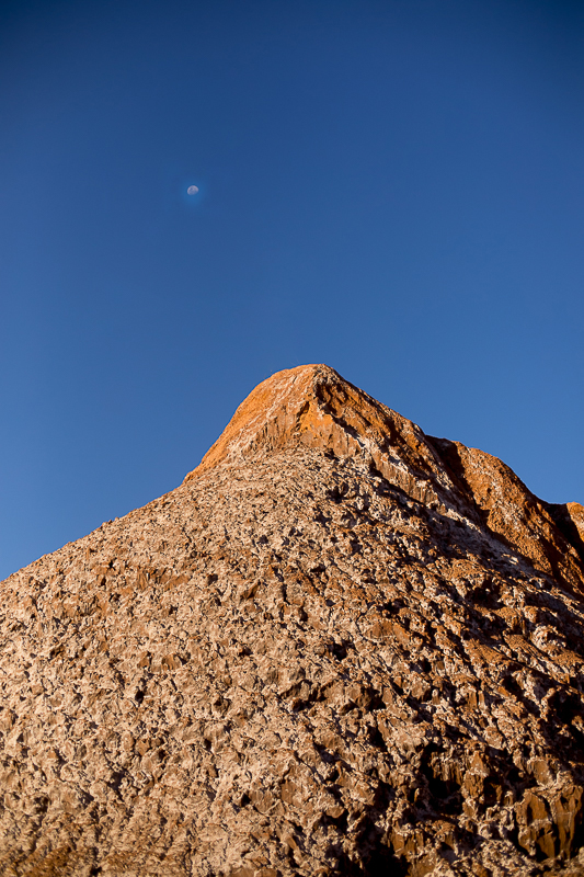 a travel photo of the valley of the moon full moon chile south america