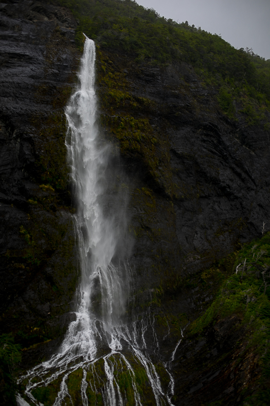 a travel photo of a waterfall in los glaciares national park inside torres del paine chile south america