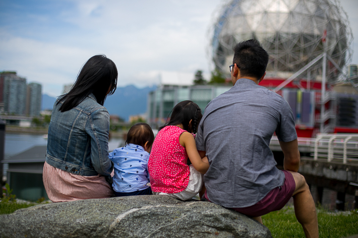a photo of a family at the science world harbourfront mountains vancouver british columbia