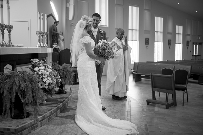 a summer wedding photo of the ceremony the secret garden in abbotsford british columbia