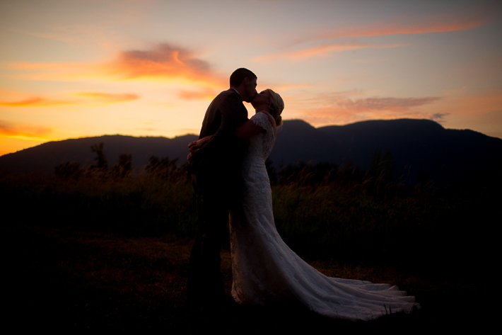 a summer wedding photo at the secret garden at sunset in abbotsford british columbia