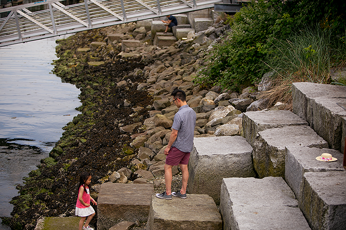 a photo of a family at the science world harbourfront rocky beach vancouver british columbia
